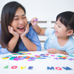 mother-daughter-studying-alphabet